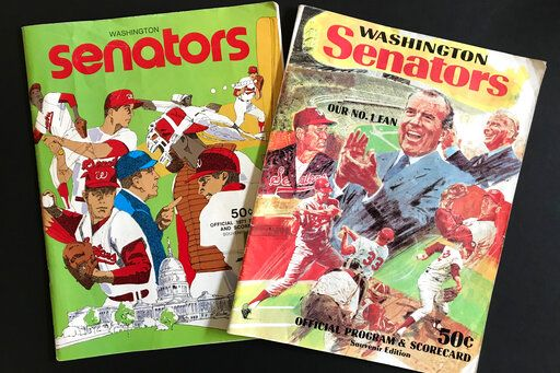 Washington Senators programs, including one featuring Richard Nixon and Ted Williams, right, are shown in New York, Tuesday, Oct. 15, 2019. Growing up in the Washington suburbs during the 1960s, the local baseball team was a lost cause. A trip to the World Series like these Nationals? Forget it.