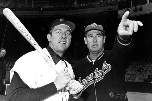 FILE - In this April 30, 1969, file photo, Detroit Tigers' Al Kaline has a baseball bat shouldered as he shares a moment with Washington Senators manager Ted Williams, in Detroit.
