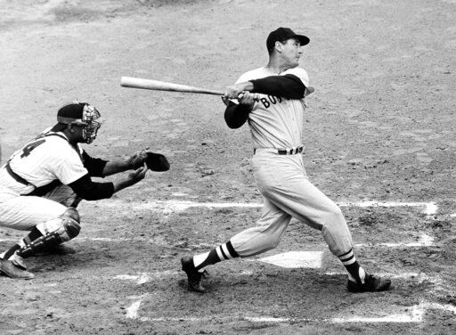 FILE - In this April 18, 1960, file photo, Ted Williams of the Boston Red Sox knocks the ball out of the park for a home run in the second inning against the Washington Senators in Washington. Growing up in the Washington suburbs during the 1960s, the local baseball team was a lost cause. So we found other things to root for under the wavy roof at D.C. Stadium and RFK. Like the time Ted Williams came to town.