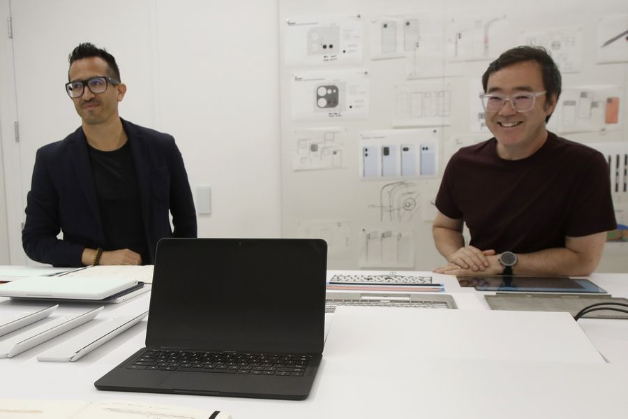 In this Tuesday, Sept. 24, 2019, photo a new Pixel laptop computer is shown in front of Alberto Villarreal, Creative Lead for Mobile and Laptops, left, and Max Yoshimoto, Design Director of Mobile and Create, at Google in Mountain View, Calif.
