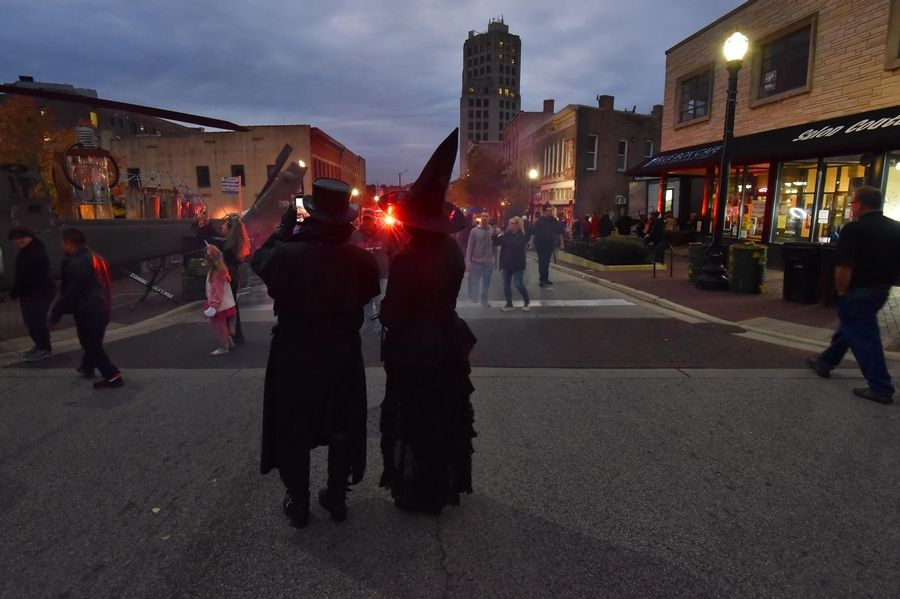 A creepy couple wanders the annual Nightmare on Chicago Street festival in Elgin Saturday.