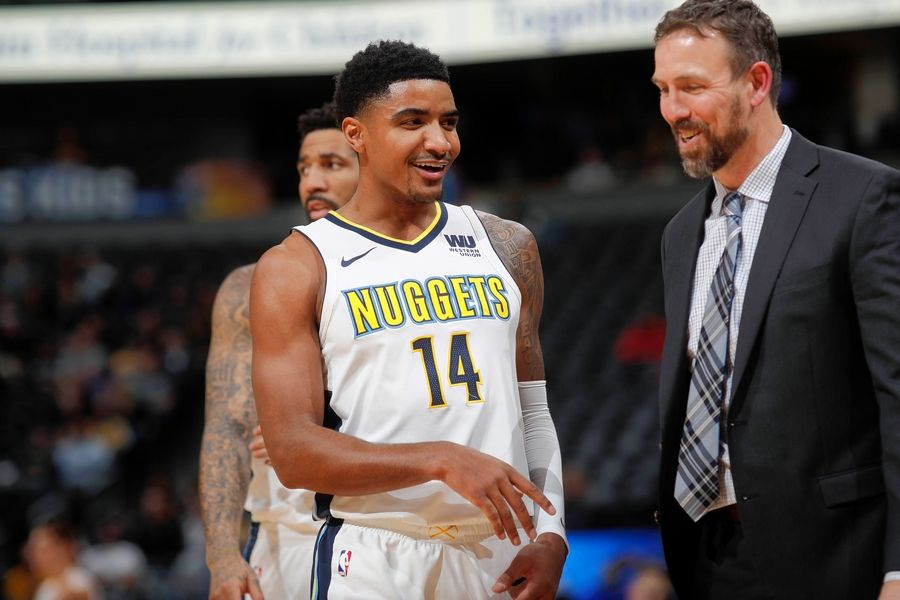 Denver Nuggets guard Gary Harris (14) jokes with Brooklyn Nets assistant coach Chris Fleming in 2016. The new Bulls assistant coach had an unusual training ground. The New Jersey native spent 20 years as a player and coaching in Germany, a country not usually known for basketball.