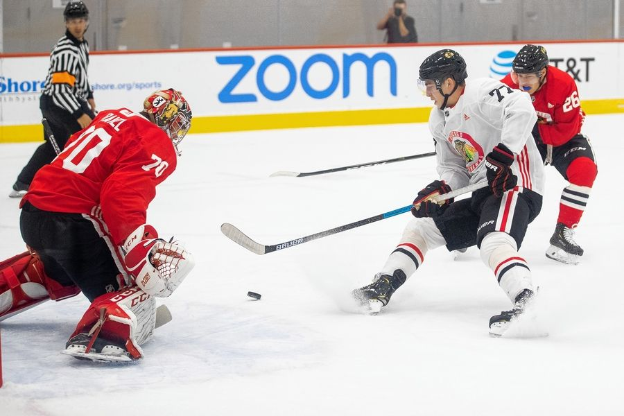 Blackhawks top prospect Kirby Dach (77) puts an exclamation point on his camp by scoring a pair of goals during the team's last scrimmage. Dach is back with the big club, but when will he make his NHL debut? It's a good question with no immediate answer, but the 18-year-old forward was happy to talk about how he'll feel once that day arrives.