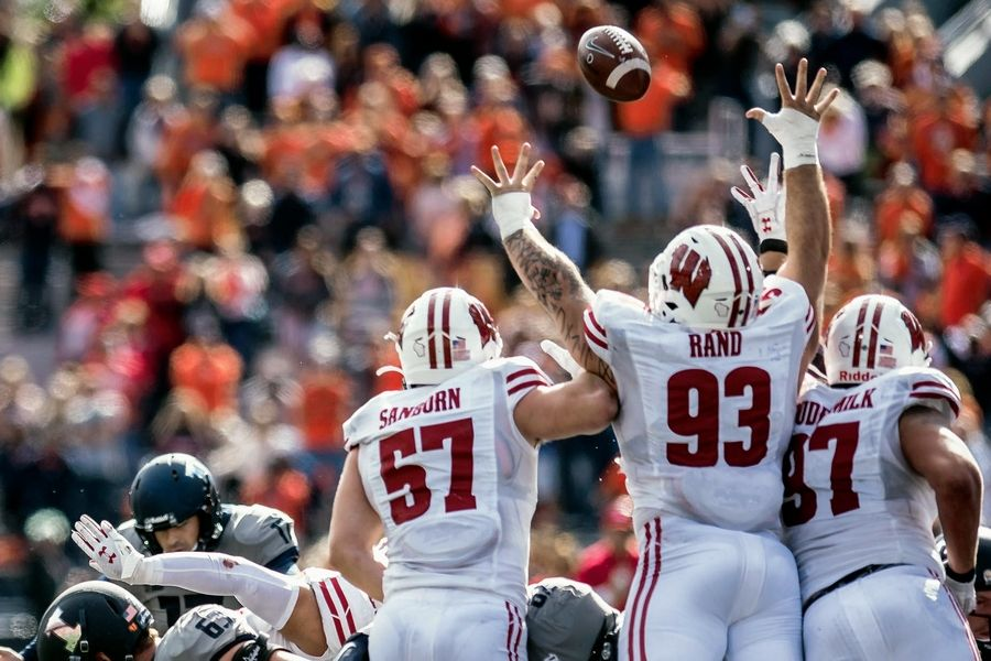 llinois kicker James McCourt, left, kicks the game-winning field goal as time expired against Wisconsin, Saturday in Champaign.