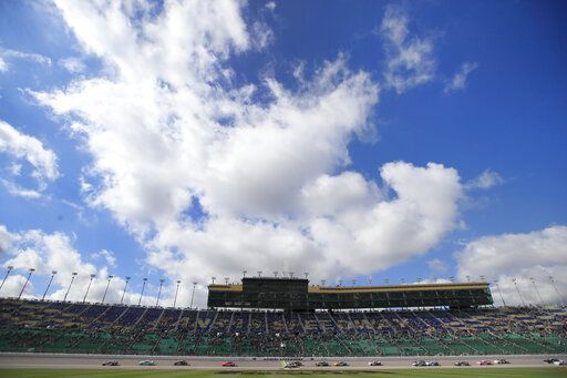 NASCAR Xfinity drivers finish an early lap during a NASCAR Xfinity Series auto race at Kansas Speedway in Kansas City, Kan., Saturday, Oct. 19, 2019.