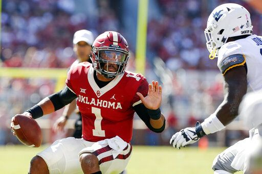 Oklahoma quarterback Jalen Hurts (1) runs against West Virginia during the first half of an NCAA college football game in Norman, Okla., Saturday, Oct. 19, 2019.