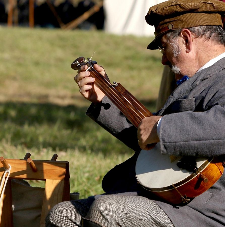 John Masciale of Palatine plays banjo Sunday during the Civil War Encampment and Battle hosted by the Northbrook Sports Club in Hainesville.