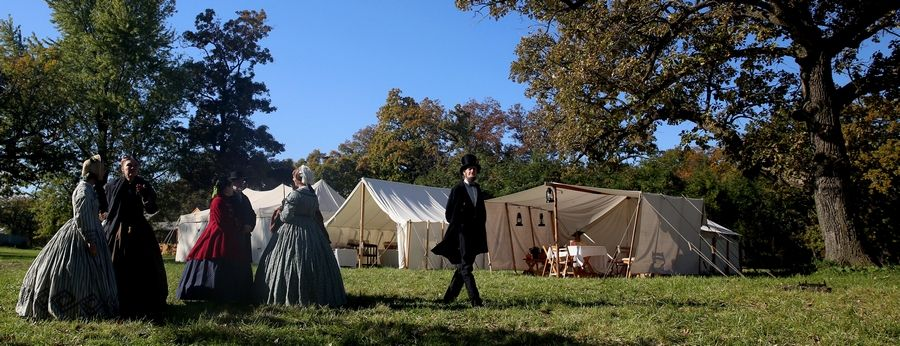 Kevin J. Wood of Oak Park portrays Abraham Lincoln as he strolls among the tents Sunday during the Civil War Encampment and Battle at the Northbrook Sports Club in Hainesville.
