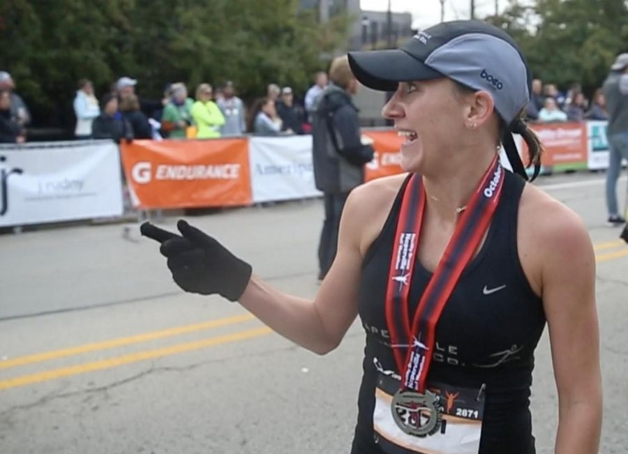 Marisa Hird of Naperville catches her breath Sunday after finishing first among women runners Sunday in the seventh annual Healthy Driven Naperville Half Marathon.