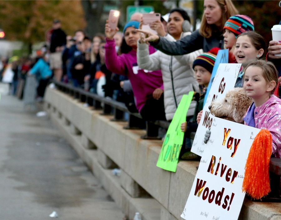 From right, Ashley Wolf, 7, Ally Wolf, 10, Katelyn Kritzer, 8, and Nolan Kritzer, 6, all of Naperville, cheer as runners begin the seventh annual Healthy Driven Naperville 5K Sunday morning.