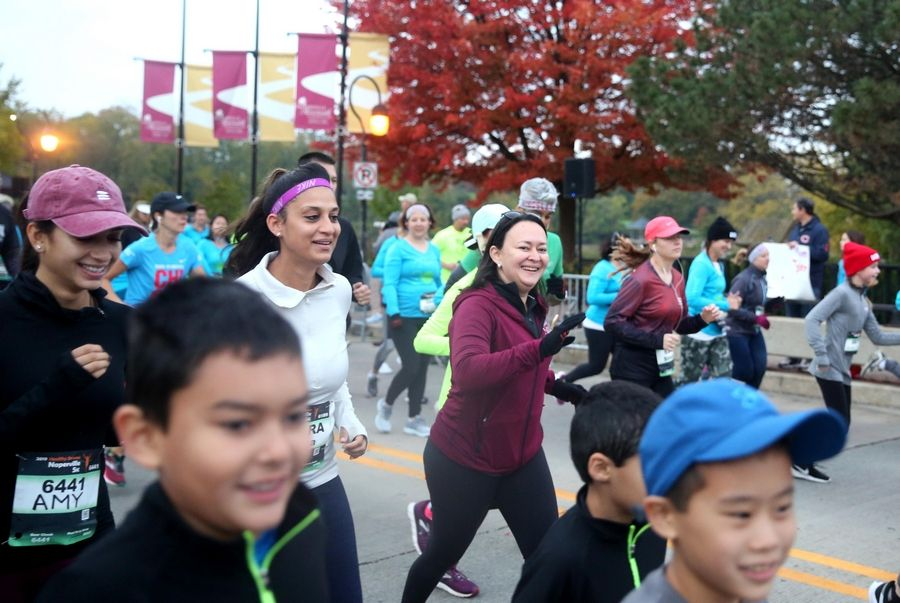 Runners begin the seventh annual Healthy Driven Naperville 5K Sunday morning. About 4,000 runners took part in the 5K and an accompanying half marathon, organizers say.