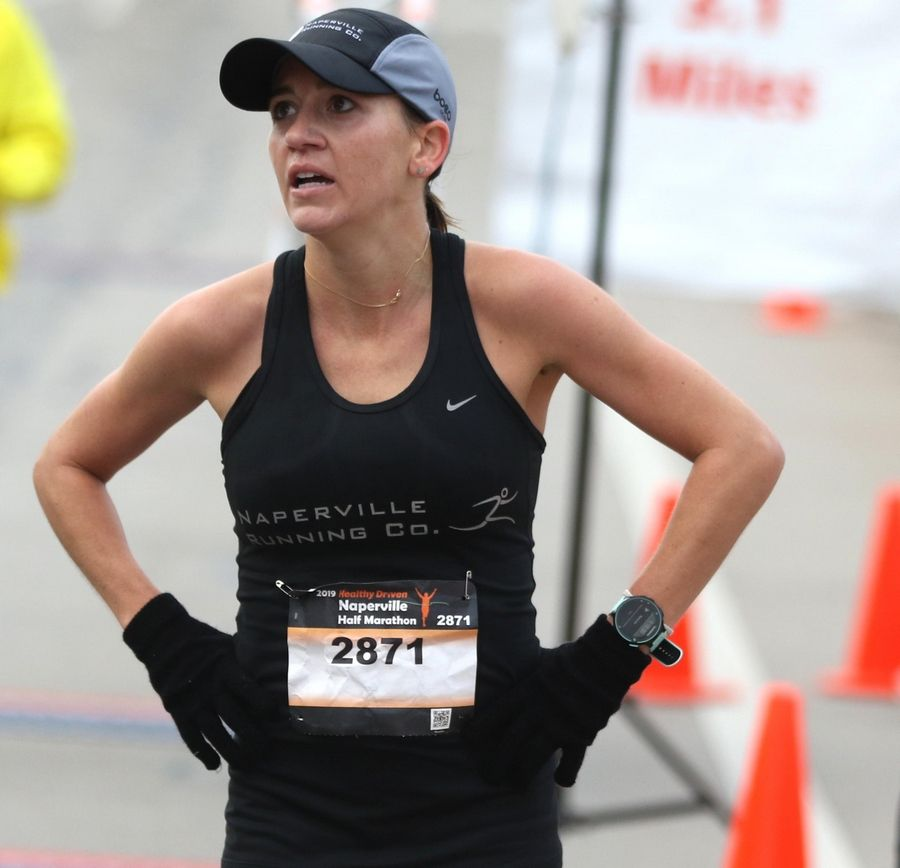 Marisa Hird of Naperville catches her breath Sunday after finishing first in the women's division of the seventh annual Healthy Driven Naperville Half Marathon.