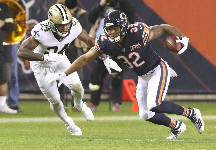 Bears running back David Montgomery carries the ball after a reception during their game against the New Orleans Saints Sunday afternoon at Soldier Field in Chicago.