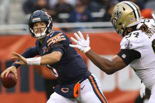 Bears quarterback Mitch Trubisky tries to throw around the rush of Saints defensive end Cameron Jordan during Sunday's game at Soldier Field in Chicago.