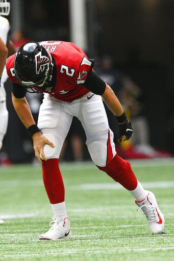 Atlanta Falcons quarterback Matt Ryan (2) stands up from the turf injured against the Los Angeles Rams during the second half of an NFL football game, Sunday, Oct. 20, 2019, in Atlanta.