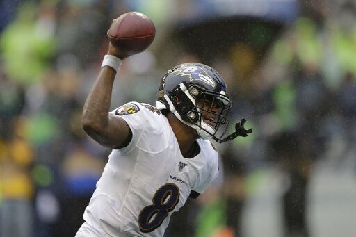 Baltimore Ravens quarterback Lamar Jackson (8) spikes the ball after a touchdown during the second half of an NFL football game against the Seattle Seahawks, Sunday, Oct. 20, 2019, in Seattle.