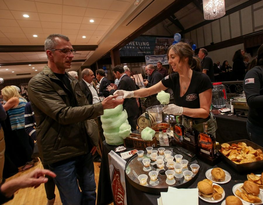 Todd Damasky gets a sample of a Spears old-fashioned from bartender Kelsie Jurik during last year's Taste of the Town in Wheeling. The restaurant returns in this year's Taste of the Town Thursday, Oct. 24.
