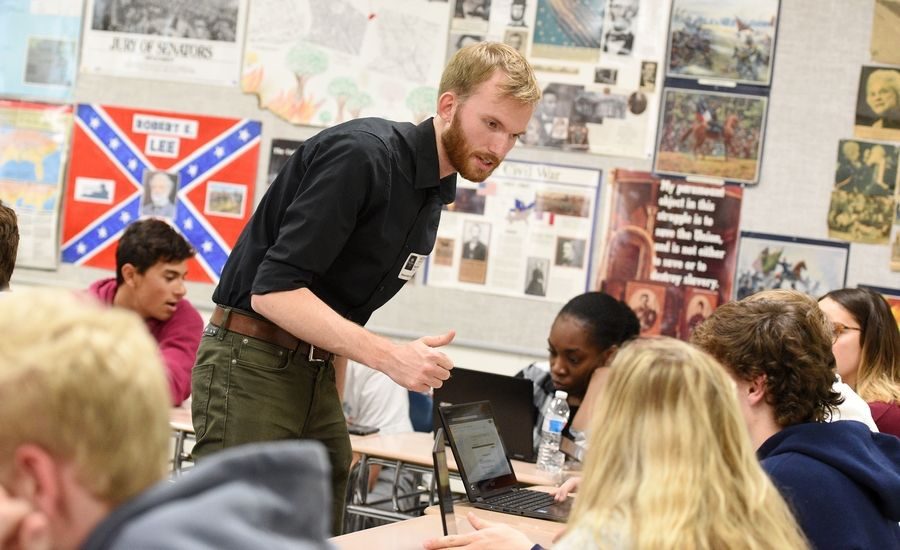 Sean van Dril works with Naperville North High School students Monday to launch a voter registration program he created called RegiStart. The program will help high school students learn about civic engagement and connect peer-to-peer to encourage each other to register to vote.