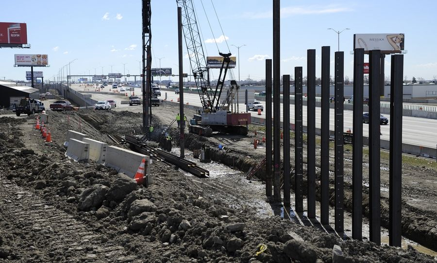 Workers are busy at the future I-490's north end, but tollway officials need to seal deals with two freight railroads to jump-start construction elsewhere.