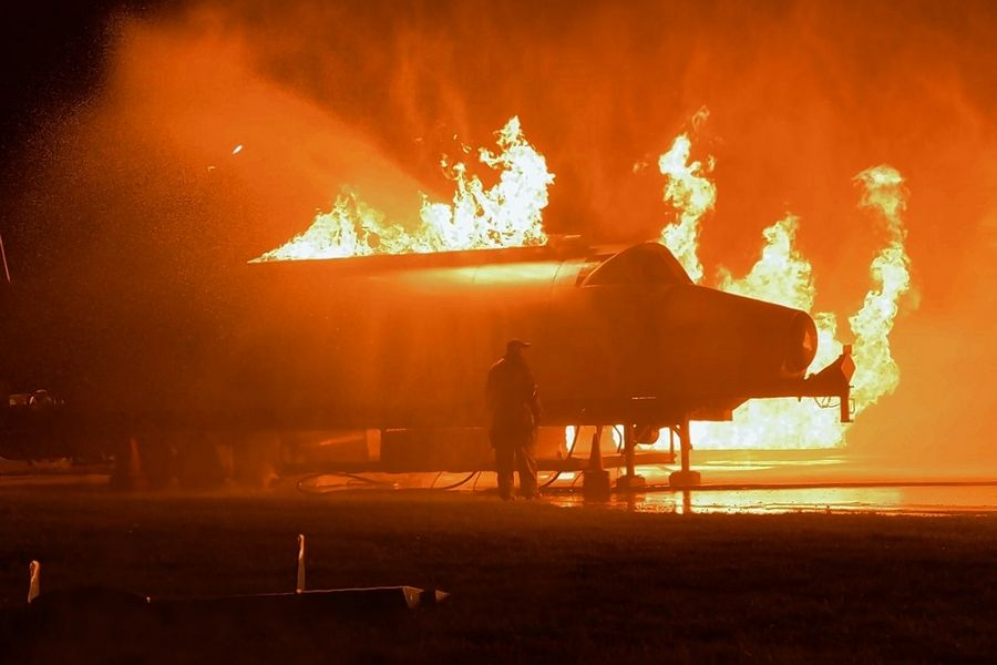 To make the scenario as realistic as possible, officials used a burn prop and school bus to create an airplane fuselage with controlled flames.