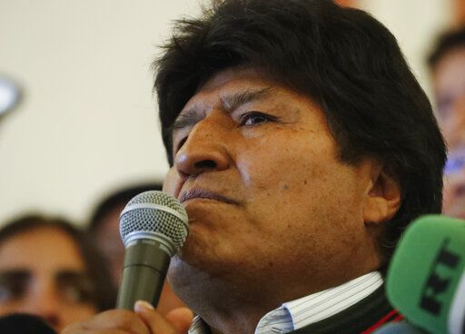 Bolivian President Evo Morales speaks to supporters at the presidential palace in La Paz, Bolivia, after a first round presidential election, Sunday, Oct. 20, 2019. Morales led in early returns from the first round of Sunday's presidential election, but he appeared headed to a runoff in the tightest political race of his life.