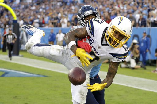 Los Angeles Chargers wide receiver Keenan Allen (13) can't hold onto a pass in the end zone as he is defended by Tennessee Titans cornerback Logan Ryan in the fourth quarter of an NFL football game Sunday, Oct. 20, 2019, in Nashville, Tenn.