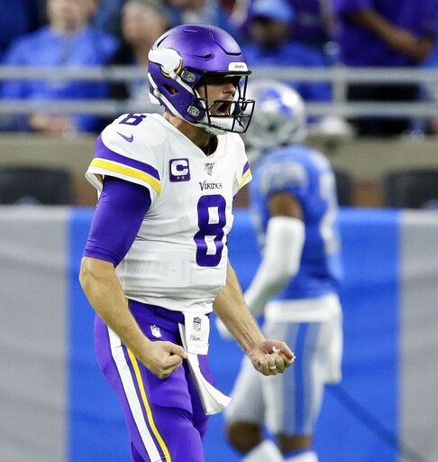 Minnesota Vikings quarterback Kirk Cousins reacts after a touchdown during the second half of an NFL football game against the Detroit Lions, Sunday, Oct. 20, 2019, in Detroit.