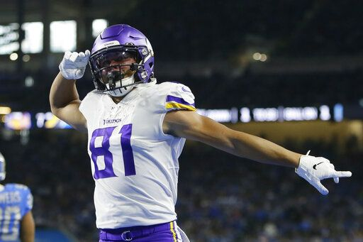 Minnesota Vikings wide receiver Olabisi Johnson reacts after catching a 1-yard pass for a touchdown during the first half of an NFL football game against the Detroit Lions, Sunday, Oct. 20, 2019, in Detroit.