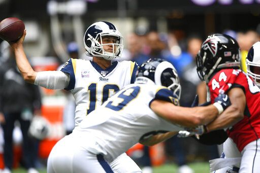 Los Angeles Rams quarterback Jared Goff (16) works in a bust pocket against the Atlanta Falcons during the first half of an NFL football game, Sunday, Oct. 20, 2019, in Atlanta.