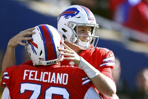 Buffalo Bills quarterback Josh Allen, right, celebrates with guard Jon Feliciano after throwing a touchdown pass to Cole Beasley in the second half of an NFL football game against the Miami Dolphins, Sunday, Oct. 20, 2019, in Orchard Park, N.Y.
