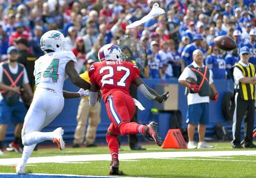 Buffalo Bills cornerback Tre'Davious White, right, jumps in front of Miami Dolphins wide receiver Isaiah Ford for an interception at the goal line in the second half of an NFL football game, Sunday, Oct. 20, 2019, in Orchard Park, N.Y.