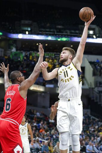 Indiana Pacers forward Domantas Sabonis (11) shoots over Chicago Bulls forward Cristiano Felicio (6) during the first half of an NBA preseason basketball game in Indianapolis, Friday, Oct. 11, 2019.