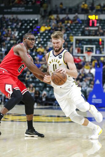 Indiana Pacers forward Domantas Sabonis (11) drives on Chicago Bulls forward Cristiano Felicio (6) during the first half of an NBA preseason basketball game in Indianapolis, Friday, Oct. 11, 2019.