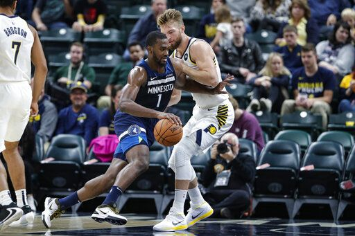 Minnesota Timberwolves forward Noah Vonleh (1) drives on Indiana Pacers forward Domantas Sabonis during the first half of an NBA preseason basketball game in Indianapolis, Tuesday, Oct. 15, 2019.