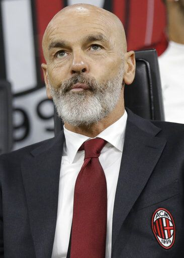 AC Milan's manager Stefano Pioli looks on at the start of Serie A soccer match between AC Milan and Lecce, at the San Siro stadium in Milan, Italy, Sunday, Oct.20, 2019.