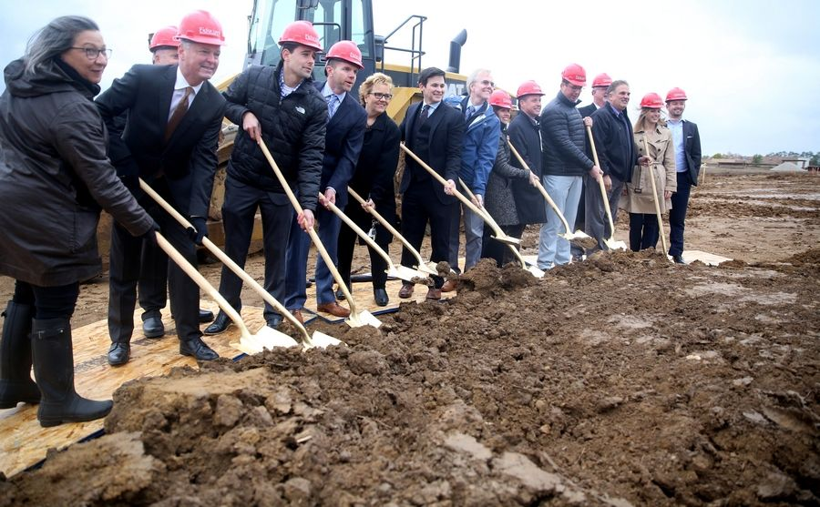 Developers, contractors and West Dundee officials participate in a ceremonial groundbreaking Tuesday for a new 300-unit apartment complex.