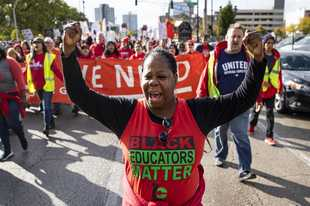 Chicago Teachers Union members and their supporters march through the Near West Side Monday after a rally in Union Park on day five of a Chicago Public Schools district-wide strike.