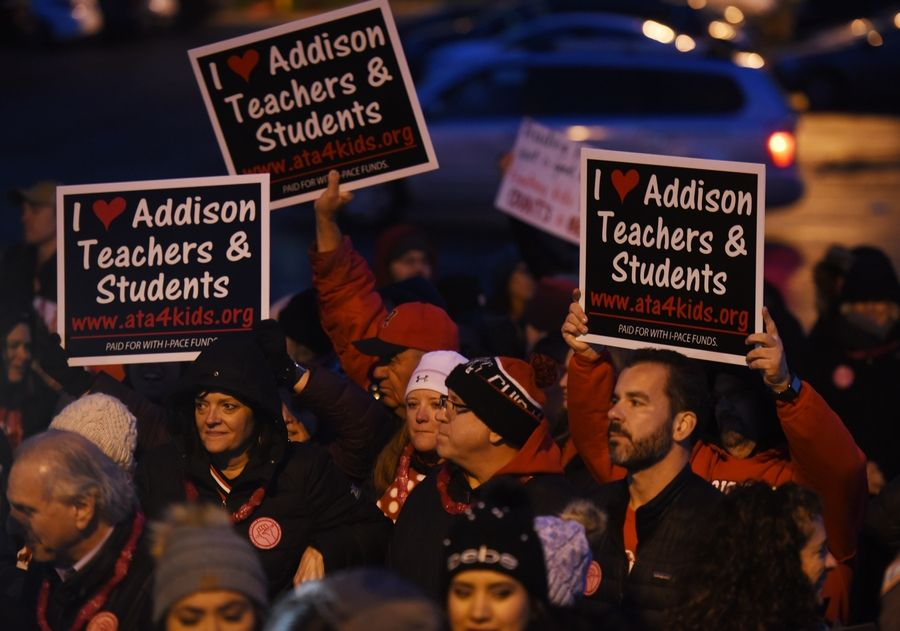 Teachers in Addison Elementary District 4 rally Tuesday night in the parking lot of Venuti's Italian Restaurant.