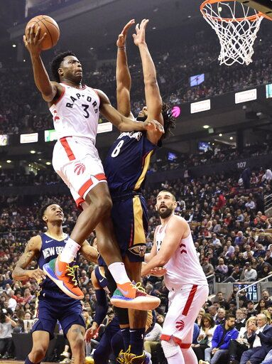 Toronto Raptors forward OG Anunoby goes to the basket as New Orleans Pelicans center Jahlil Okafor (8) defends during the first half of an NBA basketball game Tuesday, Oct. 22, 2019, in Toronto. (Frank Gunn/The Canadian Press via AP)