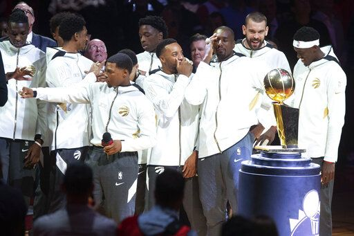 Toronto Raptors players share jokes after receiving their 2019 NBA basketball championship rings before the team's game against the New Orleans Pelicans in Toronto on Tuesday, Oct. 22, 2019. (Chris Young/The Canadian Press via AP)
