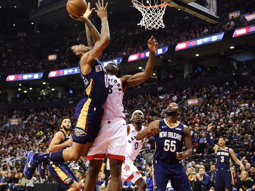 New Orleans Pelicans guard Nickeil Alexander-Walker (0) controls the ball over Toronto Raptors forward OG Anunoby (3) during the second half of an NBA basketball game Tuesday, Oct. 22, 2019, in Toronto. (Frank Gunn/The Canadian Press via AP)