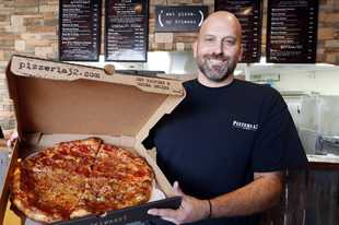 "Owner Steve Syreggelas of Pizzeria 32 in Downers Grove invites customers to follow the restaurant's slogan of ""eat pizza, my friends."" The carryout, delivery and catering shop opened late this summer at 5600 Belmont Road featuring pizzas and sandwiches with a homemade crust as well as salads, appetizers and desserts."