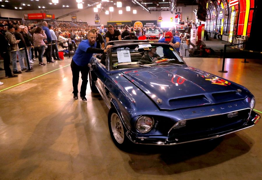 A 1968 Shelby GT500KR Mustang leaves the floor after being sold Thursday during the first day of the three-day Mecum Auctions at the Schaumburg Convention Center.