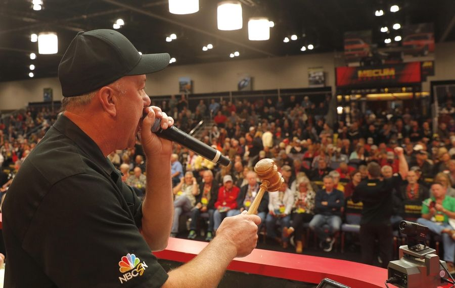 Auctioneer Russell Conklin slams the gavel on a sale Thursday during the first day of the three-day Mecum Auctions at the Schaumburg Convention Center.