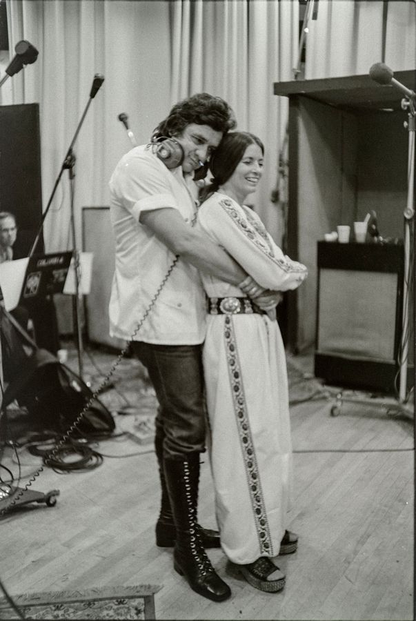 Johnny Cash met his wife June Carter Cash backstage at the Ryman Auditorium in Nashville. Here the couple records in New York in 1975.