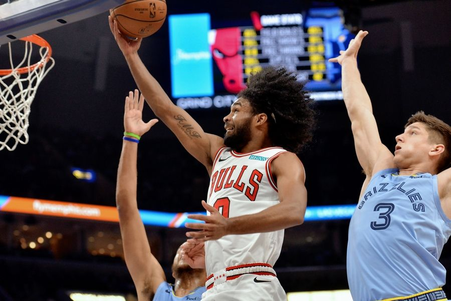 Chicago Bulls guard Coby White (0) shoots next to Memphis Grizzlies guard Grayson Allen (3) during the second half of an NBA basketball game Friday, Oct. 25, 2019, in Memphis, Tenn.