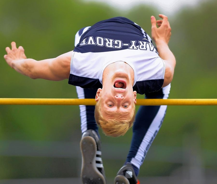 "Cary-Grove's David Aulert clears the bar and looks for the pit in the high jump at the Fox Valley Conference boys track meet at Cary-Grove High School. This photo won first place for sports photography Thursday in the Northern Illinois Newspaper Association's 2019 contest. A judge remarked, ""The facial expression, solid technique and perfect composition secured the first-place ranking."""