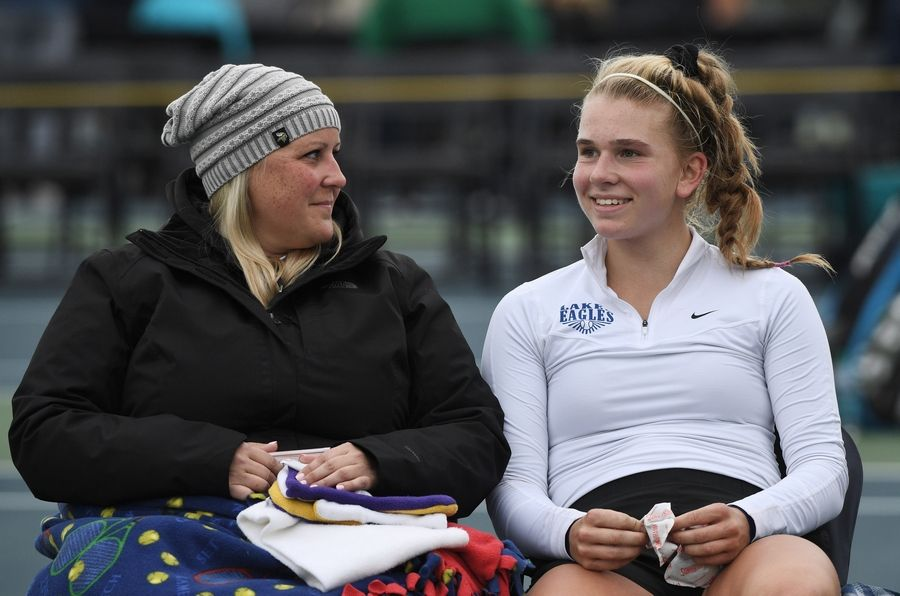 Lakes' Megan Heuser sits with assistant coach Cathryn Ingram between sets during the girls state tennis Class 1A championship at Buffalo Grove High School Saturday.