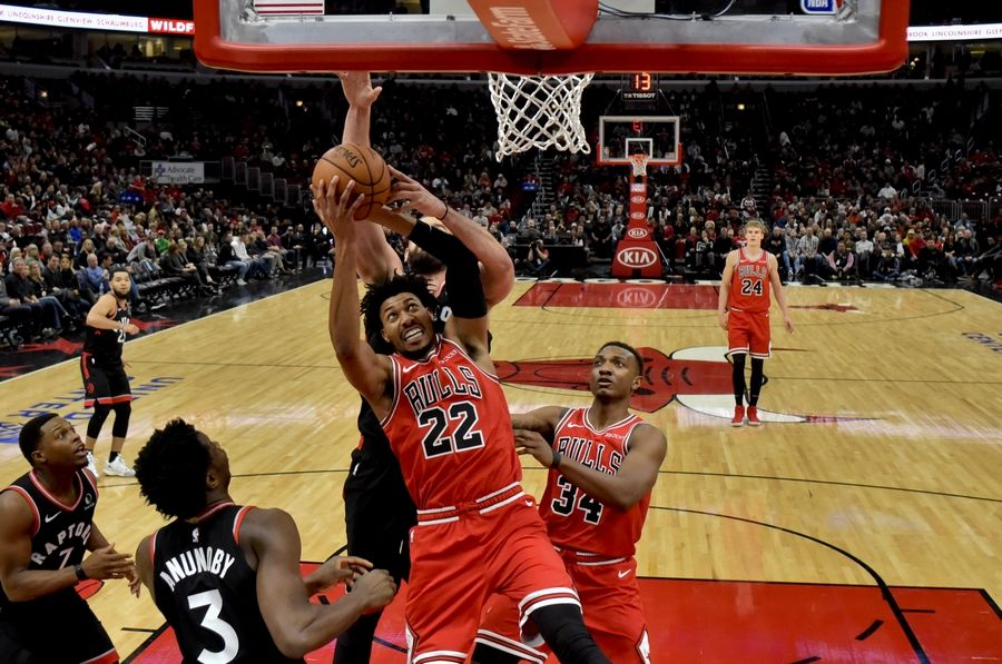 Chicago Bulls forward Otto Porter Jr. (22) shoots while defended by Toronto Raptors center Marc Gasol, center, during the second half of an NBA basketball game Saturday Oct. 26, 2019, in Chicago.