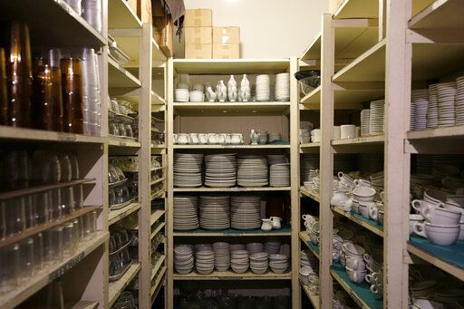 This Aug. 26, 2019, photo shows the dish room in the Decatur Masonic Temple stores thousands of dishware, each individually showing a Masonic symbol in Decatur, Ill. (Jeff Smudde/Herald & Review via AP)